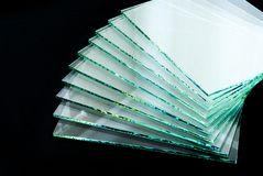 Sheets of Factory manufacturing tempered clear float glass panels cut to size royalty free stock image