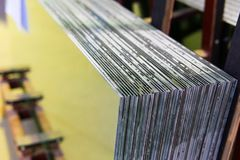 Sheets of Factory manufacturing tempered clear float glass panels cut to size.  stock photography