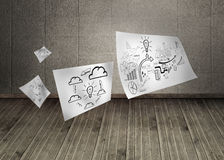 Sheets with graphics in dark room Stock Photo