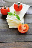 Sheets of lasagna with fresh tomatoes Royalty Free Stock Photography
