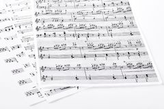 Sheets with musical notes. Pages with musical notes and keys, isolated on white background Royalty Free Stock Photos