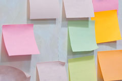 Sheets for the notes hang on a wall at office Stock Photo