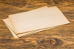 Sheets of old paper on table Stock Images