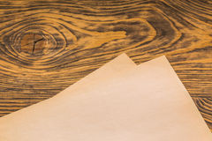 Sheets of old paper on table Royalty Free Stock Photos