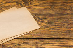 Sheets of old paper on table Stock Image