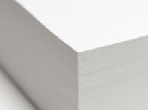 Sheets of paper. A stack of paper sheets with DOF - focus is on the corner Royalty Free Stock Photography