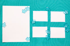 Sheets of paper on the blue drapery. With glass beads Stock Photo