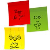 Sheets of paper with doodle Christmas and Happy New Year message Royalty Free Stock Photos
