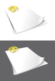 Sheets of paper and gold binder. Royalty Free Stock Photo