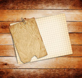 Sheets of paper on grunge wooden background Royalty Free Stock Photo