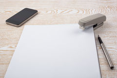 Sheets of paper and office accessories on wooden texture Royalty Free Stock Image