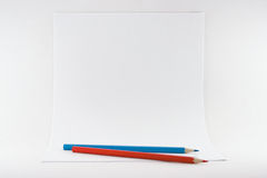 Sheets of paper with pencils Royalty Free Stock Photography