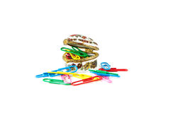 Sheets of paper pile fastened by paperclips. On white background Royalty Free Stock Image