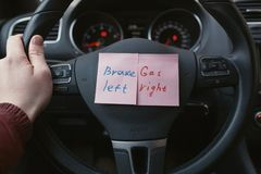 Sheets of paper with a reminder where the gas, and where to brake the car Royalty Free Stock Photo