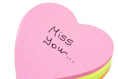 Sheets of paper with sign Miss you... Royalty Free Stock Image