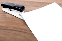 Sheets of paper stapled by stapler Stock Images