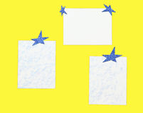 Sheets of paper with stars on a yeloow background Royalty Free Stock Photos
