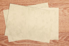 Sheets of paper on  wooden table Royalty Free Stock Photo