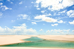 Sheets of sand under the blue sky. Lençois maranhenses are a beautiful natural park that is formed by rainy season Royalty Free Stock Photography