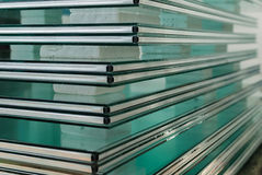Sheets of Tempered Window Glass. Sheets of Factory manufacturing tempered clear float glass panels cut to size Royalty Free Stock Photos