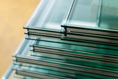 Sheets of Tempered Window Glass. Sheets of Factory manufacturing tempered clear float glass panels cut to size Royalty Free Stock Photography