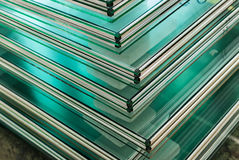 Sheets of Tempered Window Glass. Sheets of Factory manufacturing tempered clear float glass panels cut to size Royalty Free Stock Images