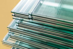 Sheets of Tempered Window Glass. Sheets of Factory manufacturing tempered float glass panels cut to size Royalty Free Stock Photos