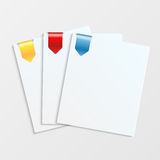 Sheets of white paper with colorful bookmarks Royalty Free Stock Images