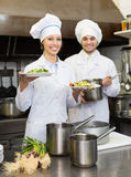 Shef and assistant preparing meal Royalty Free Stock Photo