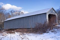 Sheffield Massachusetts covered bridge. The historic sheffield massachusetts covered bridge spanning the Housatonic River on a cold winter day stock photo