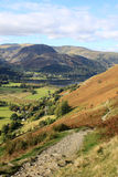 Sheffield Pike, Glenridding and Ullswater, Cumbria. View from the mountainside footpath up to Angle Tarn looking North West across he valley to Sheffield Pike ( Royalty Free Stock Photo