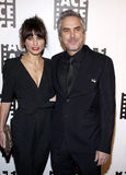 Sheherazade Goldsmith and Alfonso Cuaron Stock Image