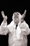 The Sheik Praying. Black and White Portrait of The Sheik Giving Praise and Homage Royalty Free Stock Photo