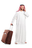 Sheik talking on phone and carrying a luggage Stock Photography