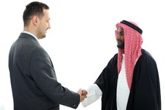 Sheikh making a deal with caucasian. Businessman Royalty Free Stock Images
