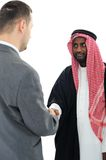 Sheikh making a deal with caucasian Stock Photography