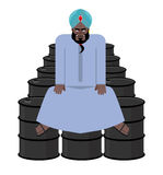 Sheikh sits on  barrels of oil. Wealth of  Sultan. Royalty Free Stock Images