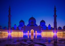 Sheikh Zayed Grand Mosque in Abu-Dhabi. Illuminated in the dusk royalty free stock image