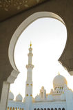 Sheikh Zayed Grand Mosque. The Sheikh Zayed Grand Mosque in Abu Dhabi, UAE is framed by an arch Stock Photo
