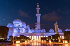 Sheikh Zayed Grand Mosque Centre Abu Dhabi illuminated at night with blue color. The white terraces. Royalty Free Stock Images