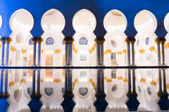 Sheikh Zayed Grand Mosque Centre Abu Dhabi illuminated at night with blue color. The white terraces. Stock Images
