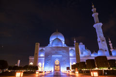 Sheikh Zayed Grand Mosque Centre Abu Dhabi illuminated at night with blue color. The white terraces. Stock Photo