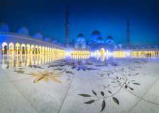 Sheikh Zayed Grand Mosque at dusk, Abu-Dhabi, UAE. View of floral pattern on the floor of Sheikh Zayed Grand Mosque at dusk, Abu-Dhabi, UAE Royalty Free Stock Image
