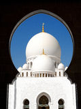 Sheikh Zayed Grand Mosque main dome seen through the main arch Royalty Free Stock Image