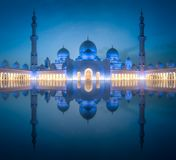 Sheikh Zayed Grand Mosque at night Abu-Dhabi, UAE. View of Sheikh Zayed Grand Mosque at night with reflection on water, Abu-Dhabi, UAE royalty free stock photos