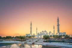 Sheikh Zayed Grand Mosque at sunset Abu-Dhabi, UAE. View of Sheikh Zayed Grand Mosque from the road during sunset, Abu-Dhabi, UAE. Clipping path of sky royalty free stock image