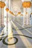 Sheikh Zayed Mosque, Abu Dhabi. Sun rays passing through pillar at corridors of Sheikh Zayed mosque, Abu Dhabi Stock Photos