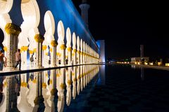 Sheikh Zayed Mosque pillars reflected in the water royalty free stock image