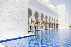 Sheikh Zayed Mosque Right Corridor with Pool, The Great Marble Grand Mosque at Abu Dhabi, UAE Royalty Free Stock Photo