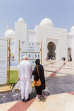 Sheikh Zayed Mosque with Touristsare Reading Information, The Great Marble Grand Mosque at Abu Dhabi, UAE Royalty Free Stock Images